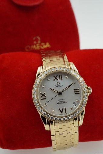 Omega Omega DeVille ladies yellow gold - original diamonds - serviced 40867500 .